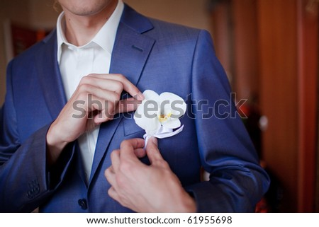 Groom getting flowers