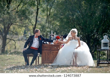 groom gives the bride flowers - stock photo