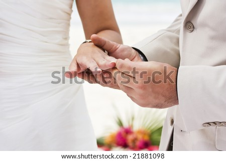 Groom giving an engagement ring to his bride