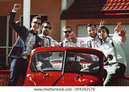 groom   groomsmen posing in...