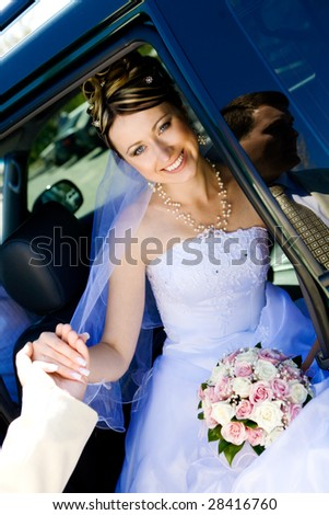 groom helps to bride to leave a car