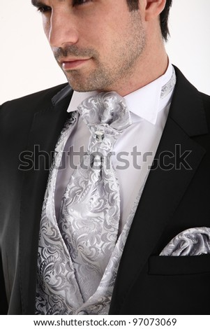 Groom in pose in white background