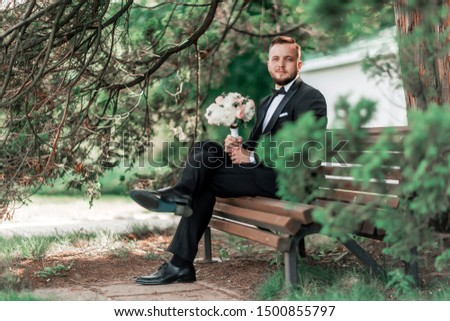 groom is waiting for the bride sitting sitting on the bench. #1500855797