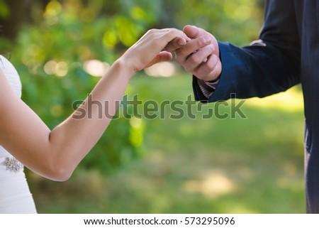groom kiss bride`s hand