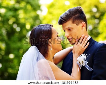 Groom kissing bride outdoor. #181991462