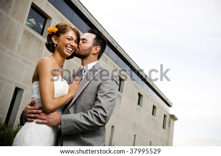 Groom kissing his new bride