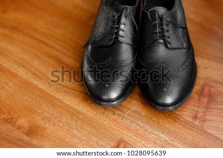 Groom's stylish and elegant dark brown leather shoes. footwear on an isolated background
