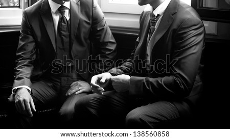 groom speaks with its witness of wedding