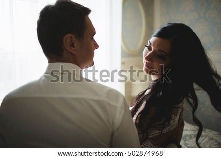 groom spends funny time with his wife #502874968