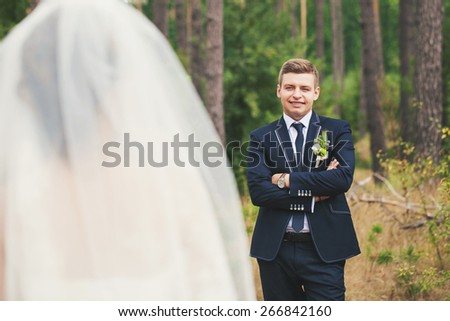Groom suit and bride in wedding white dress on nature