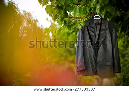 Groom suit hanging by the tree