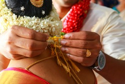 Groom tie a Thali/Tali knot to the Bride to take care of her for the entire life.Traditional Kerala Hindu Wedding Knot popularly known as Thali/Tali.It is a union of two individuals as spouses.