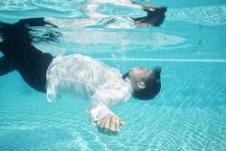 groom underwater