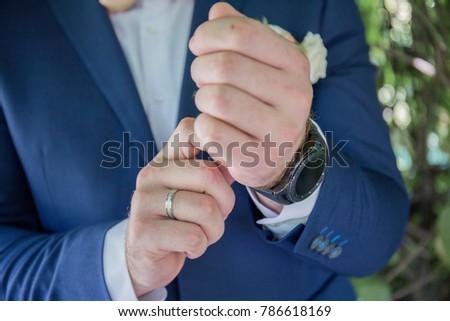 groom wears a watch #786618169
