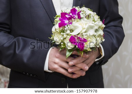 groom with wedding bouquet