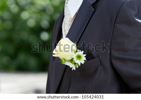 Groom with white rose on his suit