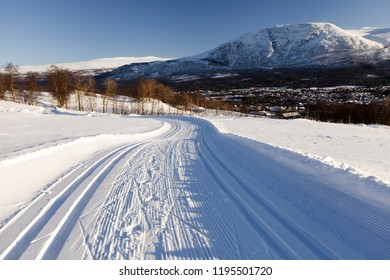 Stock photo of groomed ski trails for cross-country in Oppdal, Norway. Ttracks for classic skiing at the sides, groomed for skate skiing in the center.