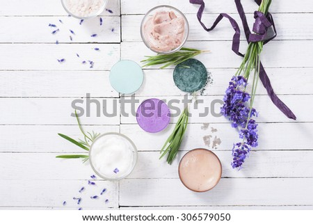grooming products and fresh lavender bouquet on white wooden table background