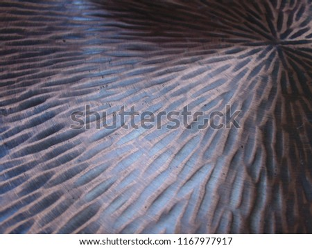 Grooved and textured closeup of a vintage brushed brass like brown copper plate