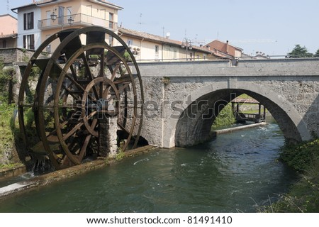 Groppello d'Adda (Milan, Lombardy, Italy), ancient bridge and watermill in a sunny summer morning