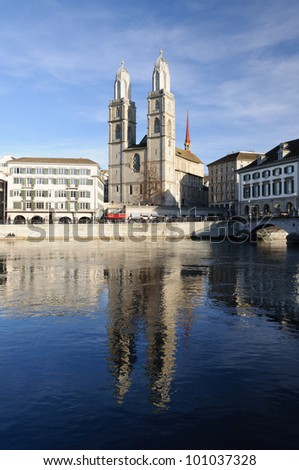 Grossmuenster church reflecting on the river Limmat in Zurich