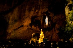 Grotto in Lourdes, France, by night where Bernadette Soubirous saw a vision ot the Virgin Mary in a cave called Massabielle near the Gave river.