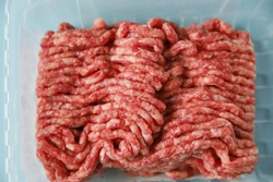 Ground beef in packing – natural or artificial cultured meat, close up