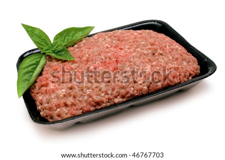 Ground beef (mince) on black foam tray with Basil garnish, isolated on white with clipping path