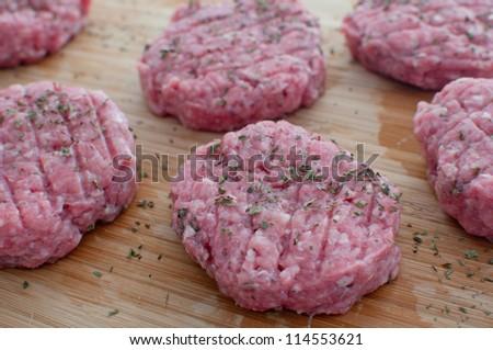 Ground beef patties uncooked closeup horizontal