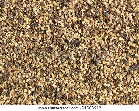 Ground black pepper (coarse) - close-up; can be used as a background