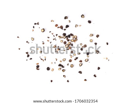 Ground black pepper isolated on a white background top view
