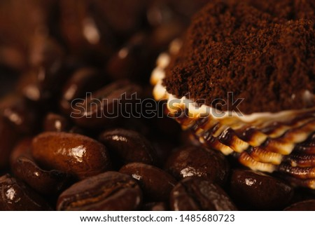 Ground coffee beans on a shell