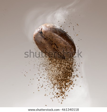 Ground coffee falling from the bean