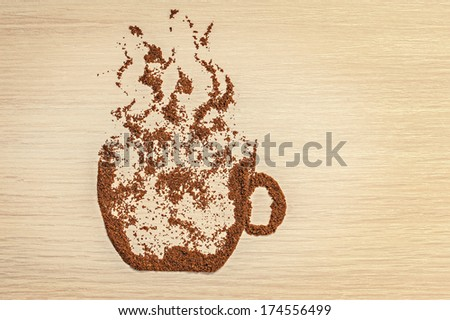 ground coffee in the form of coffee cup on the table