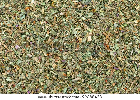 Ground dried Basil (Sweet Basil) texture, full frame background. Used as a spice in culinary herb all over the world. The plant is also used in medicine.