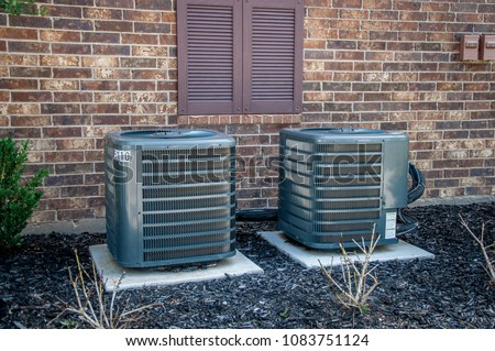 Ground HVAC units placed by a building outside