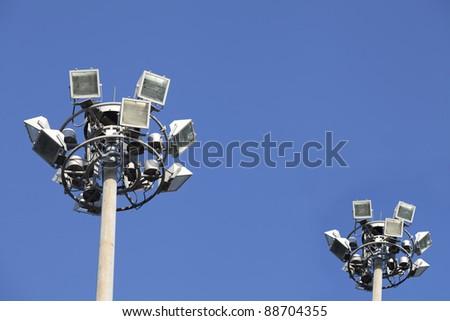 Ground light (traffic light) pole on blue sky background