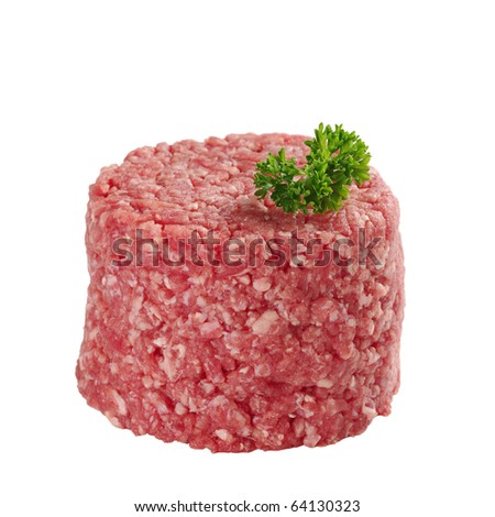 Ground meat with parsley on top isolated on white (Selective Focus, Focus on front and parsley)