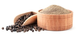 Ground pepper and peppercorns in a wooden bowl close-up on a white. Isolated