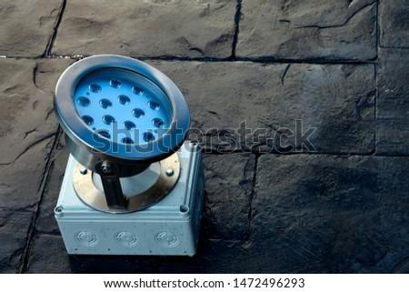 ground spotlights installation or spotlights on black concrete floor use for technology background #1472496293