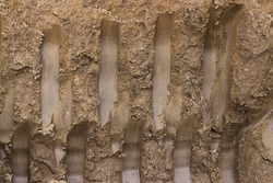 Ground texture background, with small rocks and dust. Excavation dirt texture exposed.