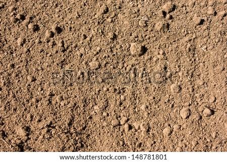 Ground textured surface background under bright sunlight