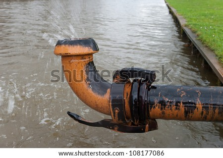 ground water being pumped away into a pond