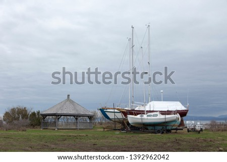 Grounded sailboats and wooden gazebo on the grounds near the Rivière-du-Loup to Saint-Siméon ferry terminal, Rivière-du-Loup, Quebec, Canada #1392962042