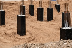 Groundwork for new building foundation. Concrete column blocks with rebars