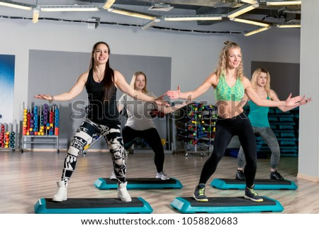 group aerobics with a coach in the gym