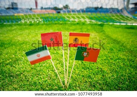 Group B - Portugal, Spain, Morocco, IR Iran - National Flags on green grass on football stadium #1077493958