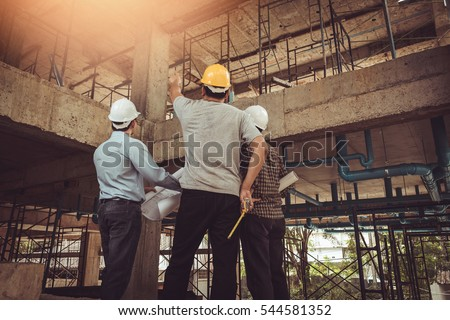 Shutterstock Group business man construction site engineer, effect Vintage sun flare.