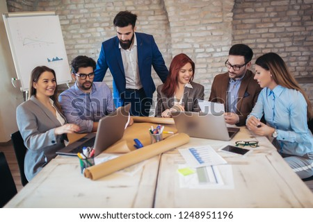 Group business people meeting to discuss ideas in modern office #1248951196