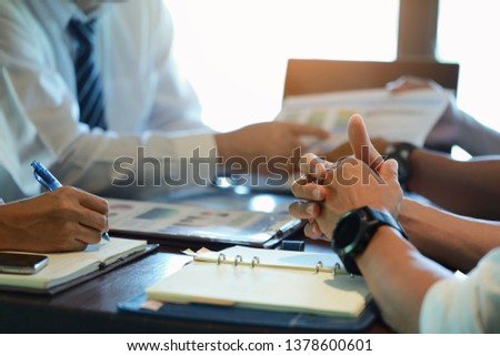 Group businessman meetings to brainstorm, analyze and plan for marketing. #1378600601